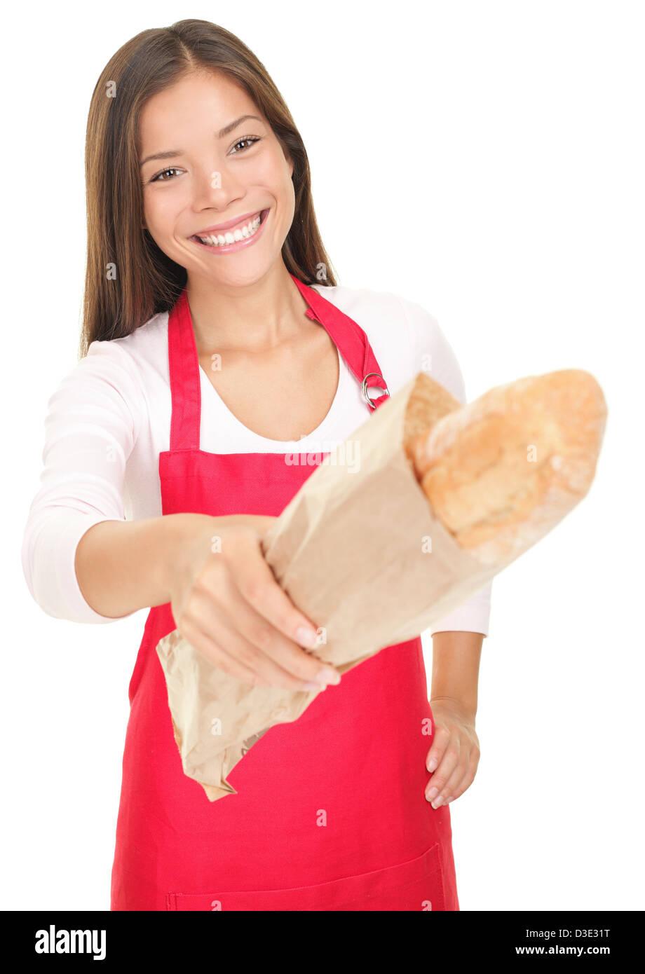 Portrait of beautiful mixed race caucasienne / Asian Woman, commis en donnant du pain à client isolé sur Photo Stock