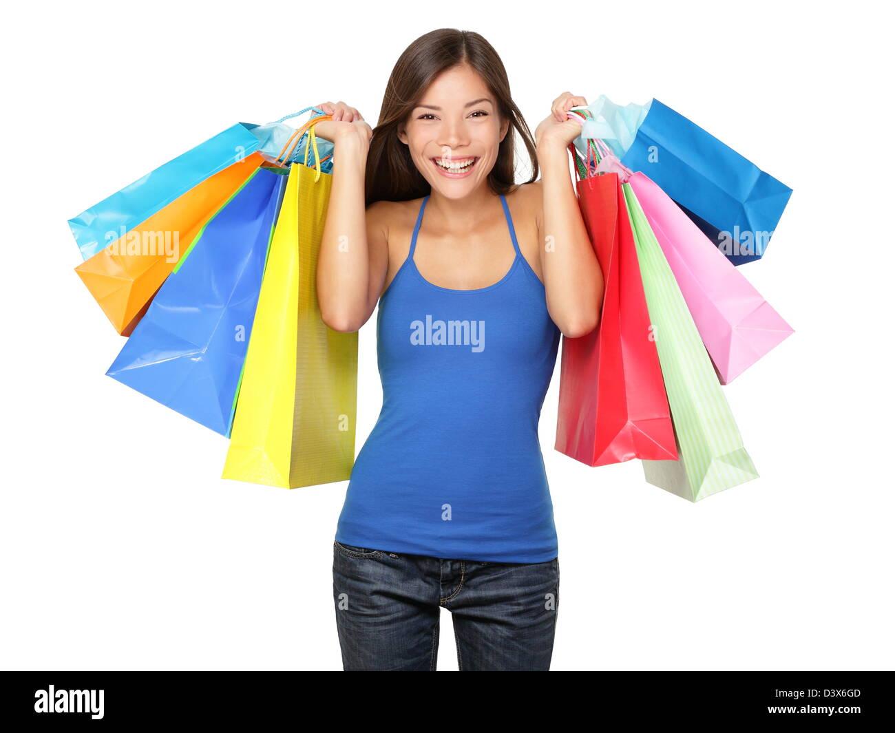 Belle jeune asiatique / Chinois multiraciale Caucasian woman holding shopping bags colorés de nombreux isolé Photo Stock