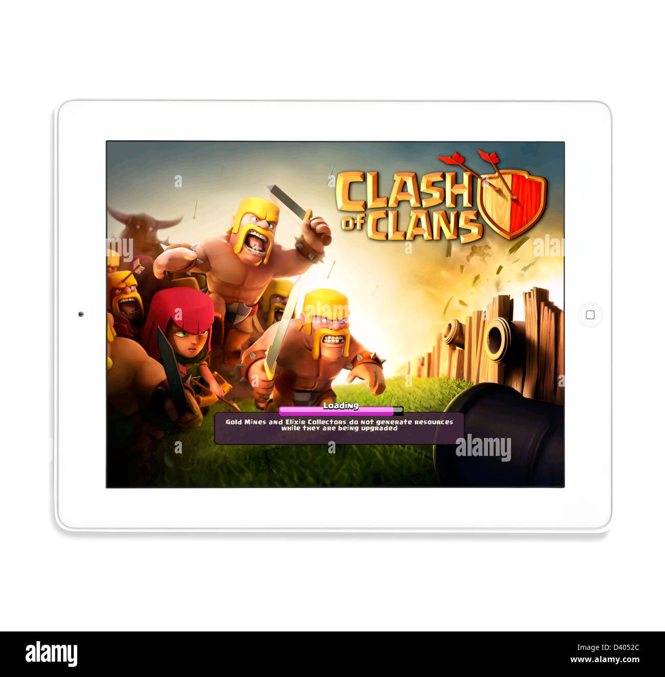 La lecture de la populaire jeu gratuit Clash of clans sur un iPad 4e génération Photo Stock