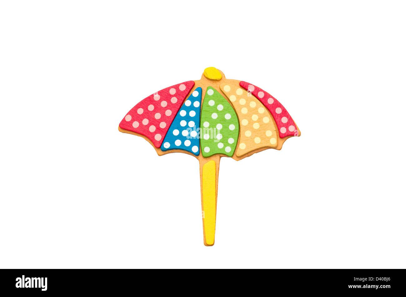 Parapluie de plage isolé sur fond blanc. Photo Stock