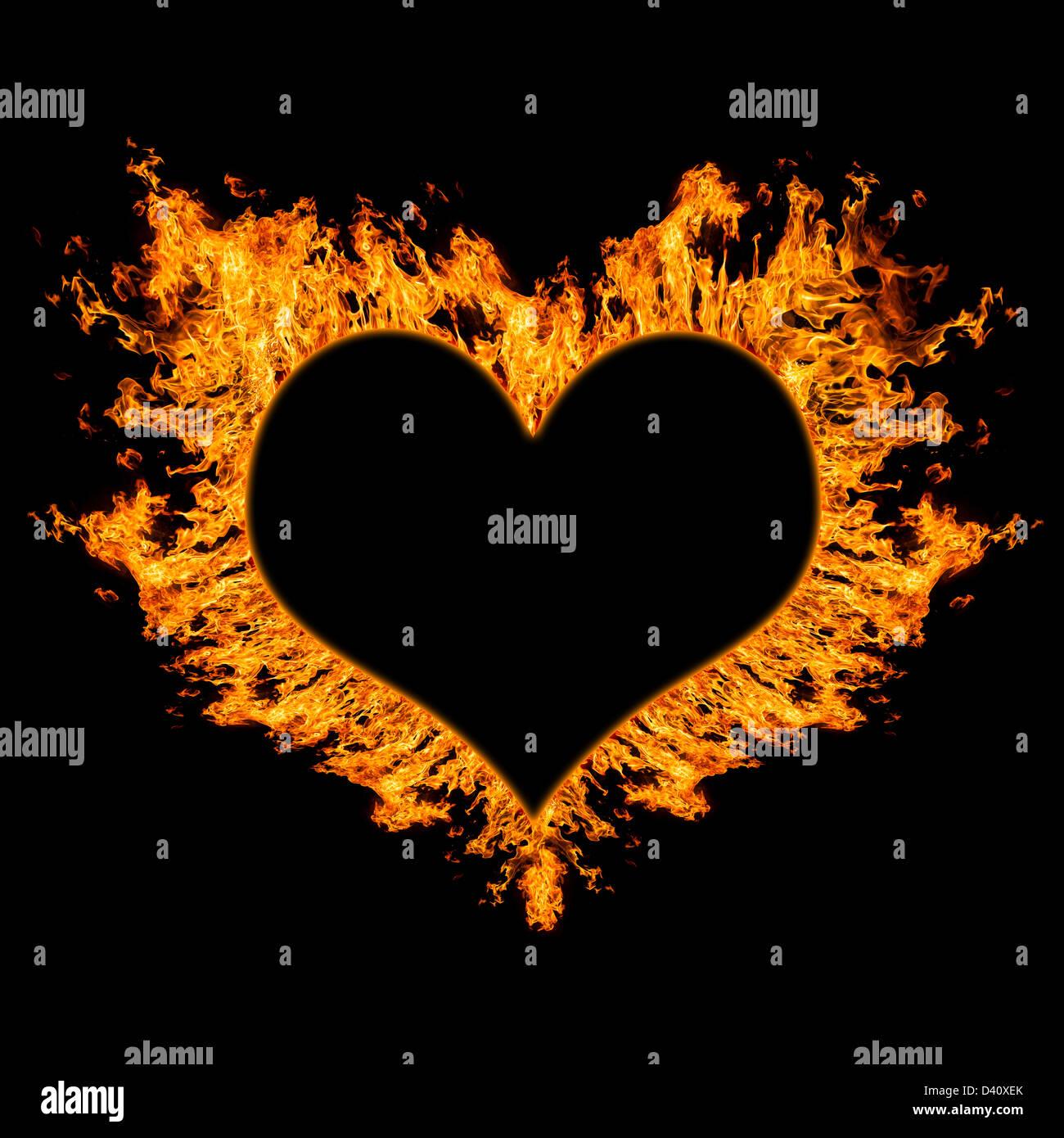 Fiery coeur sur fond noir. Banque D'Images