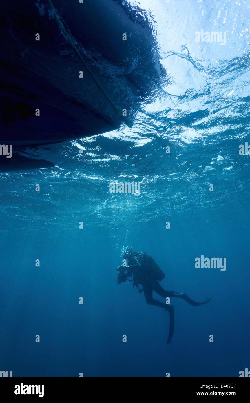 Plongeur en un bateau Photo Stock