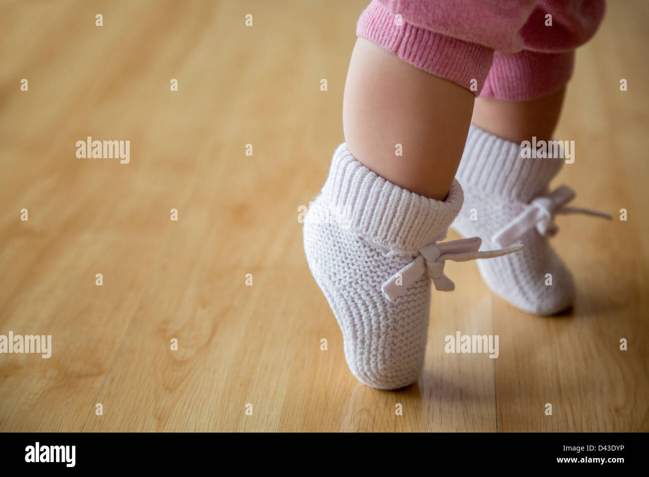 Baby Girl in pink booties Banque D'Images