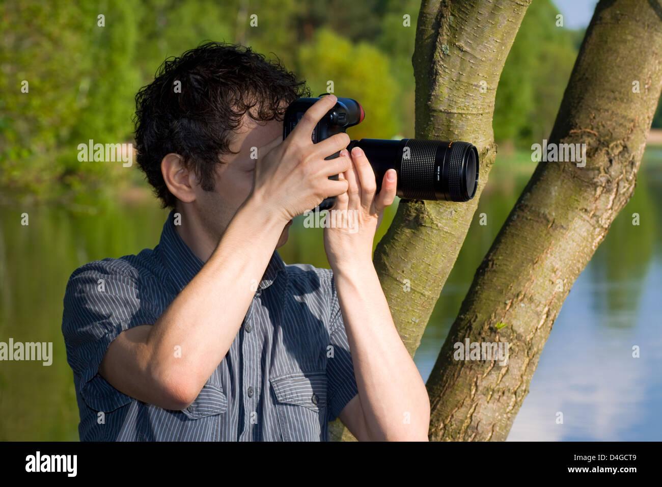 Photographe sournois se son tir de la nature Photo Stock