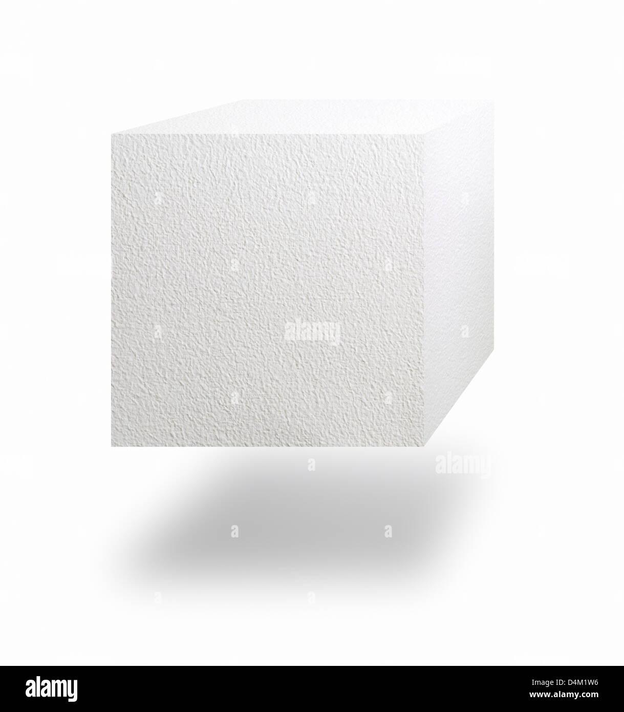 Cube papier flottant dans l'air sur fond blanc Photo Stock