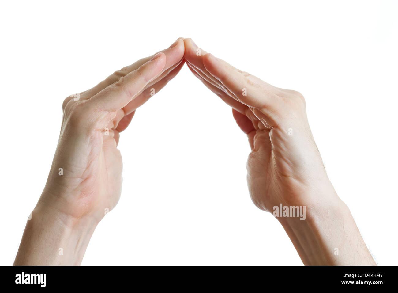Mains en forme de maison sur fond blanc Photo Stock