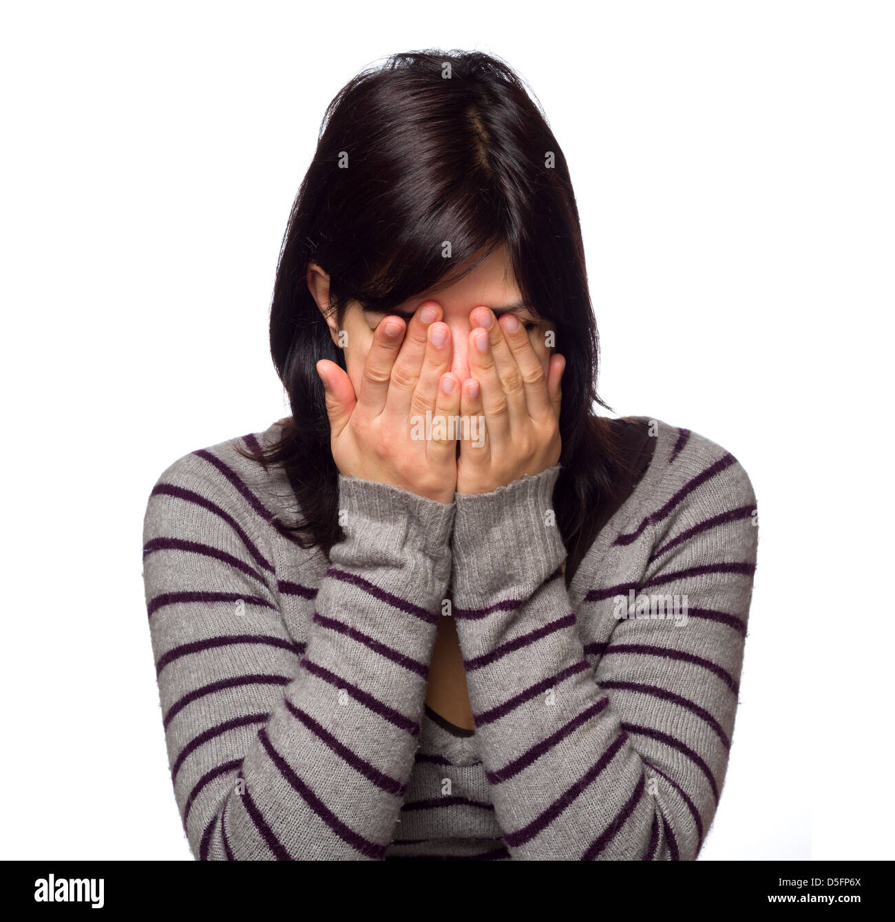 Portrait of young woman with hands covering face Banque D'Images