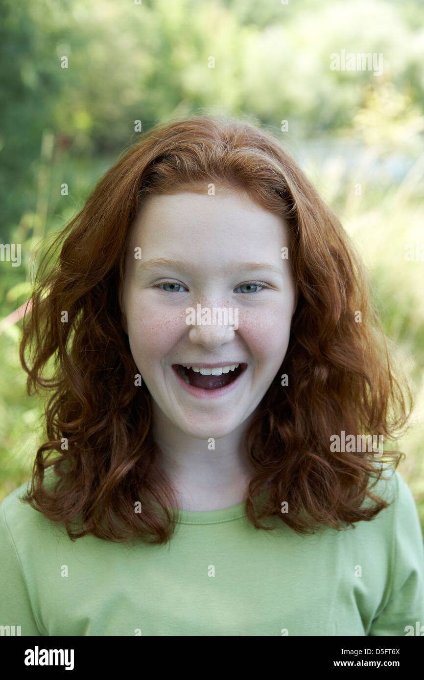 Red haired girl laughing Photo Stock