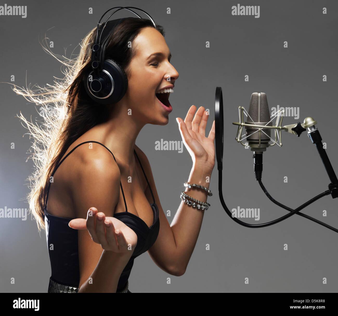 Studio shot of singing rockstar Photo Stock