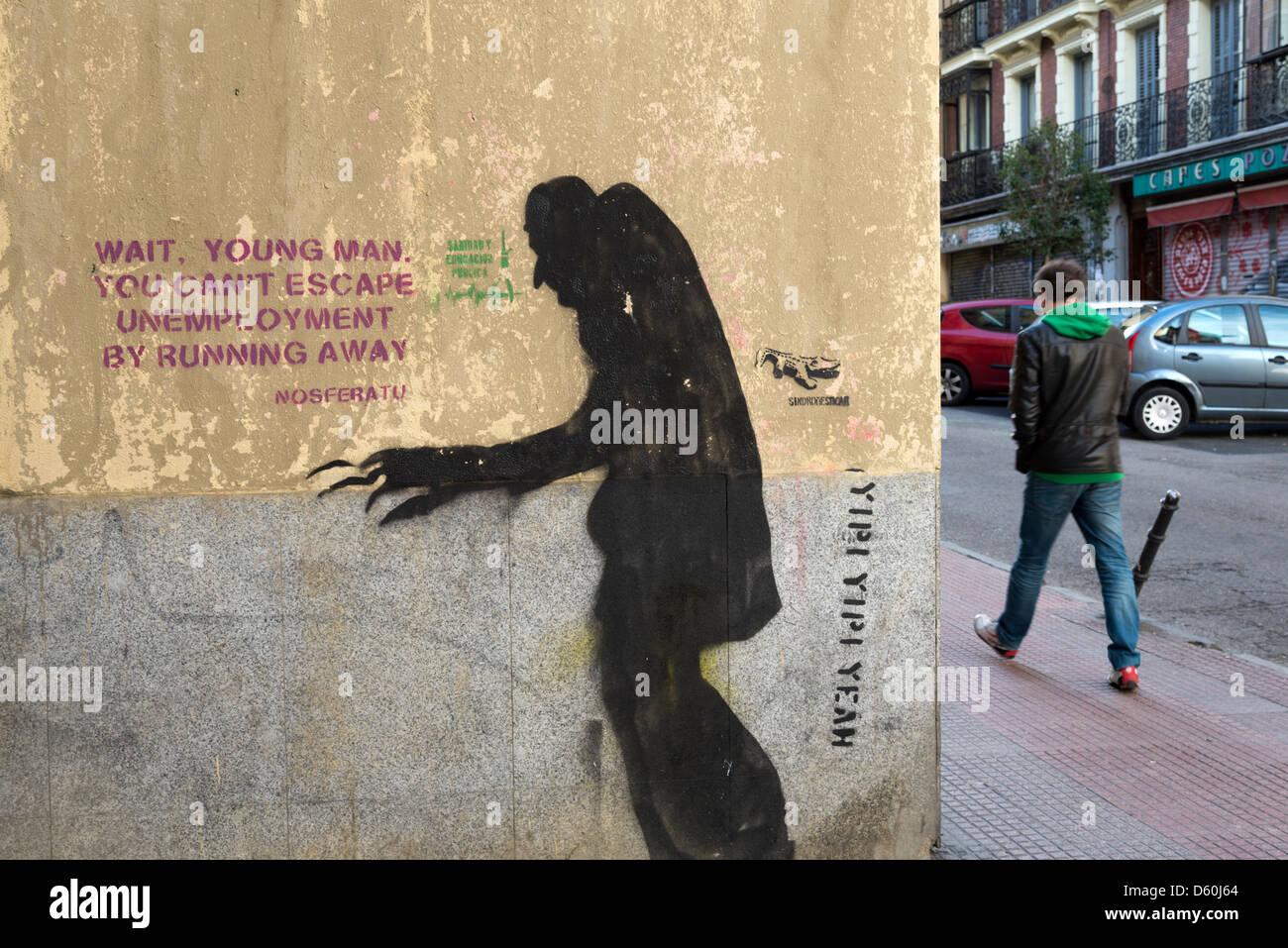 À propos de graffiti sur un mur du chômage en Espagne Photo Stock