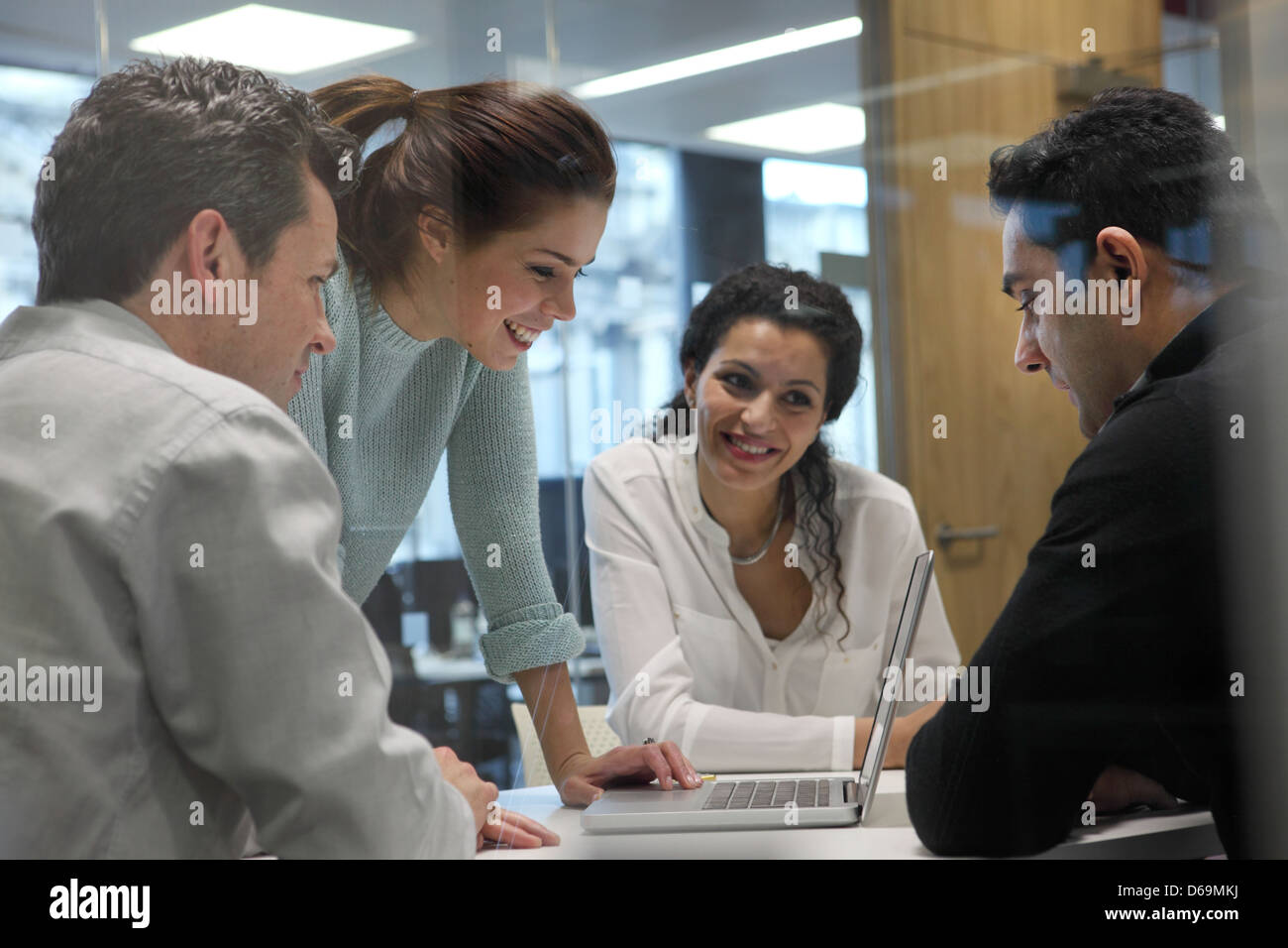 Business people using laptop in meeting Photo Stock
