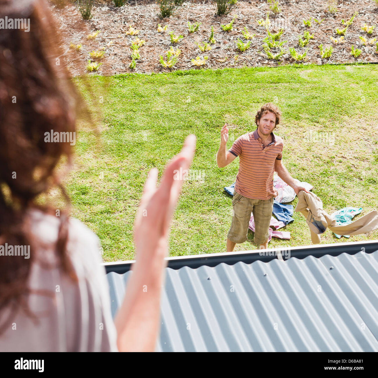 Woman arguing with boyfriend in backyard Photo Stock