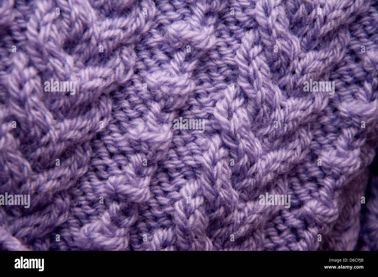 Vêtement en bonneterie de laine en close up, texture, détail, résumé, côté allumé, Photo Stock