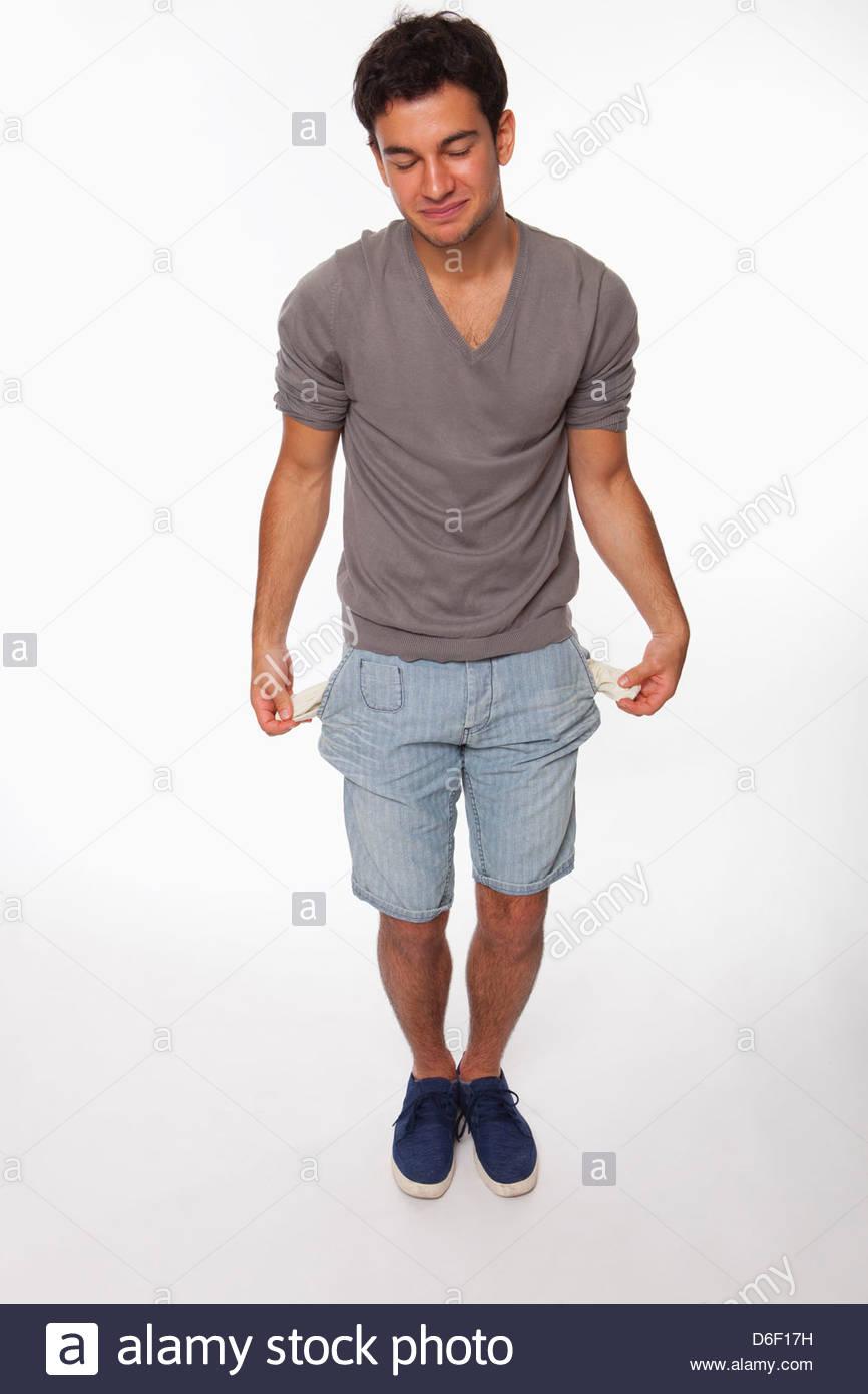 Mâle adolescent pauvres poches vides de la pauvreté d'argent Photo Stock