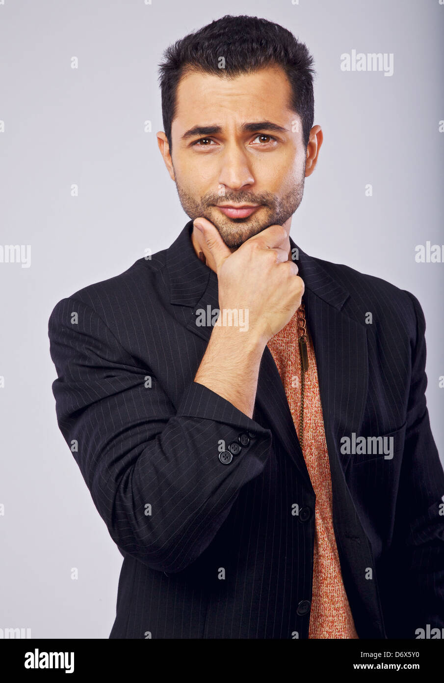 Arrogant handsome man posing in a studio Photo Stock
