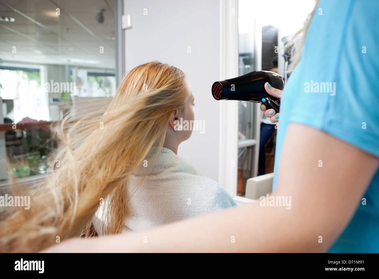 Blow drying Hair Photo Stock