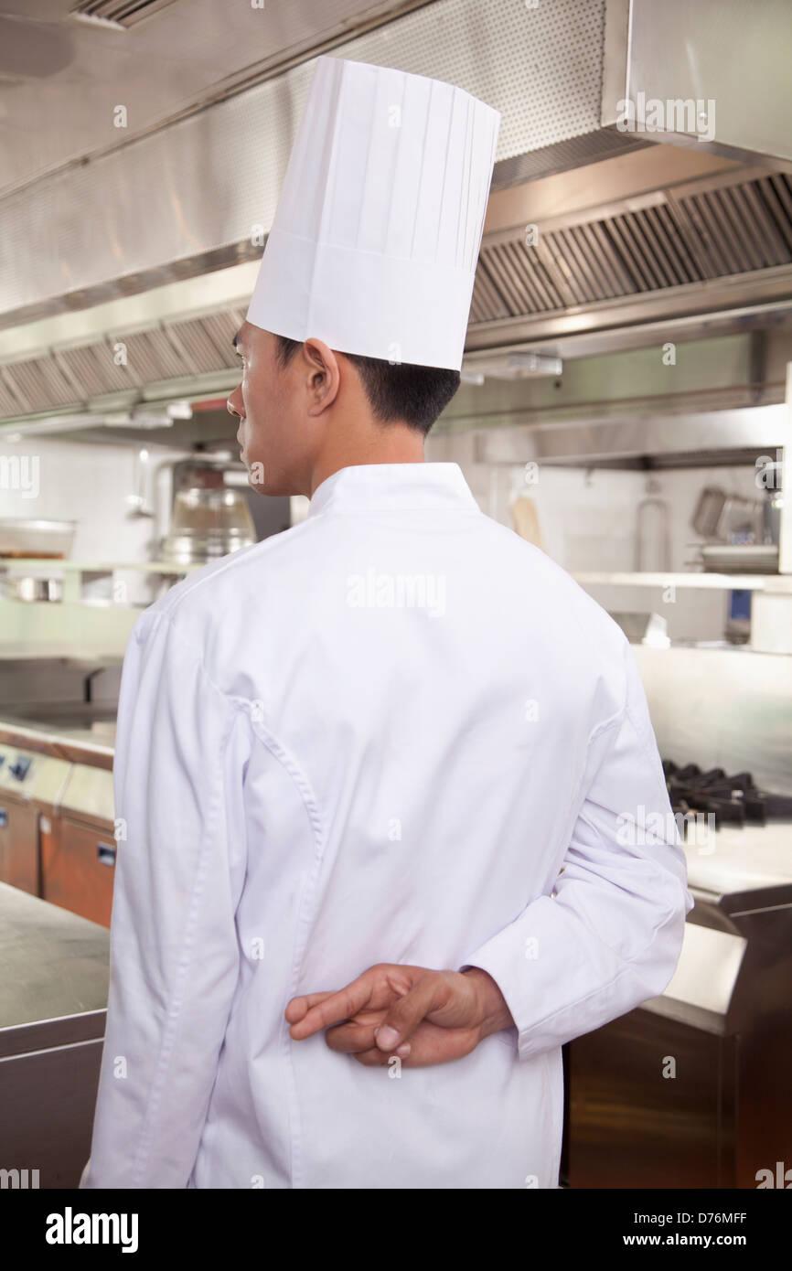 Chef avec les doigts croisés Photo Stock