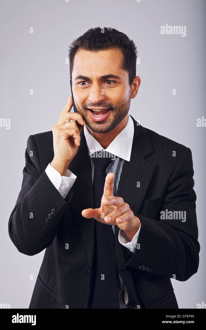 Successful businessman having a phone conversation Photo Stock