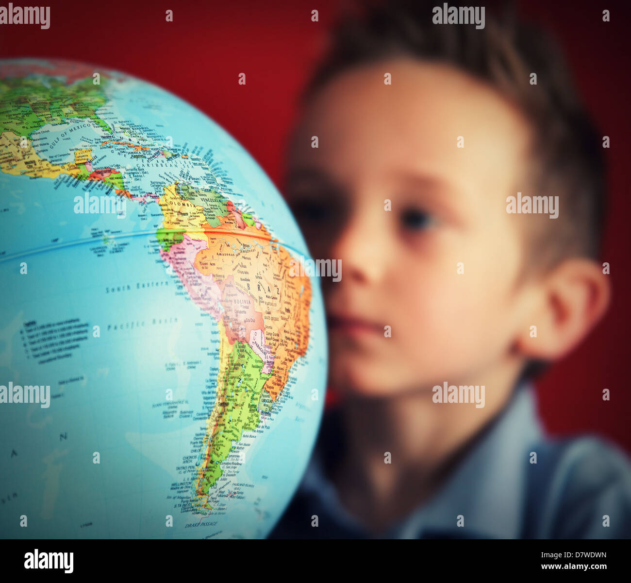 School boy looking at globe Photo Stock