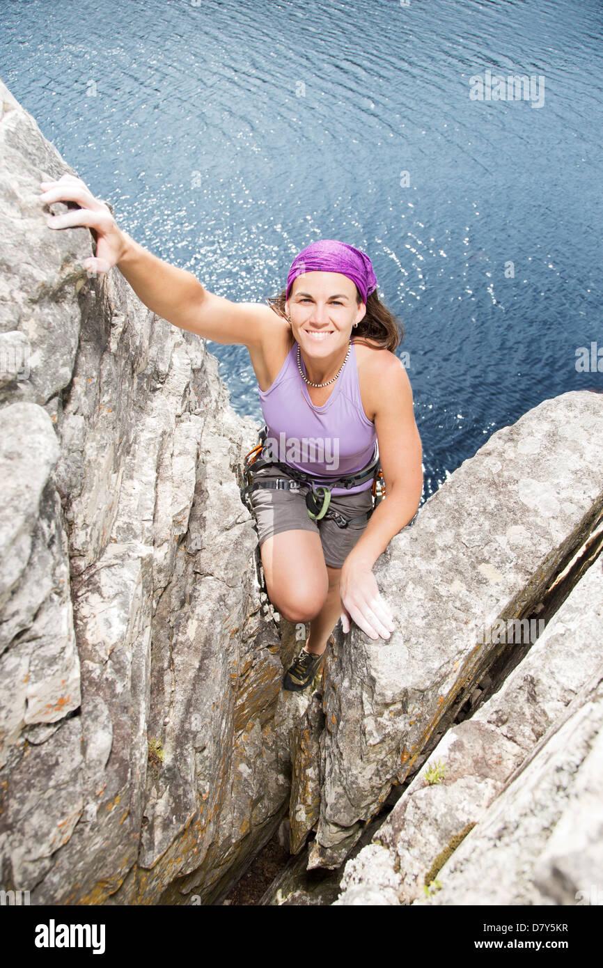 Climber scaling rock face Photo Stock