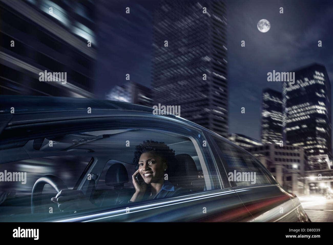 African American Woman driving on cell phone Banque D'Images
