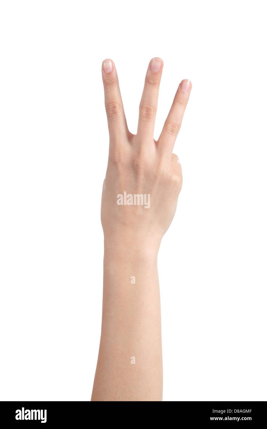 Main femme montrant trois doigts sur un fond isolé blanc Photo Stock