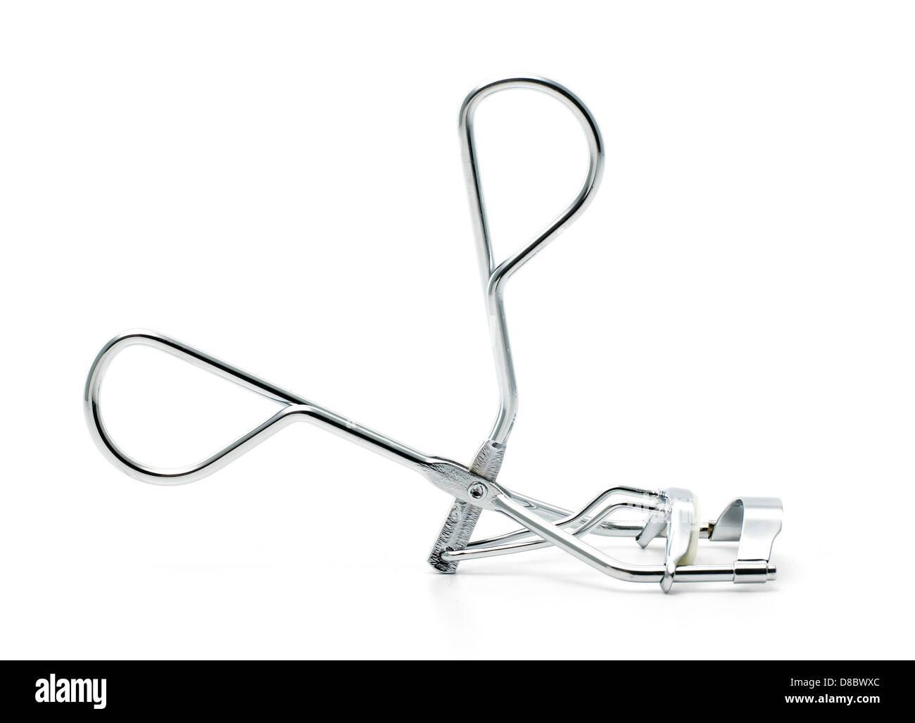 Silver metal eyelash curlers cu tout sur un fond blanc Photo Stock