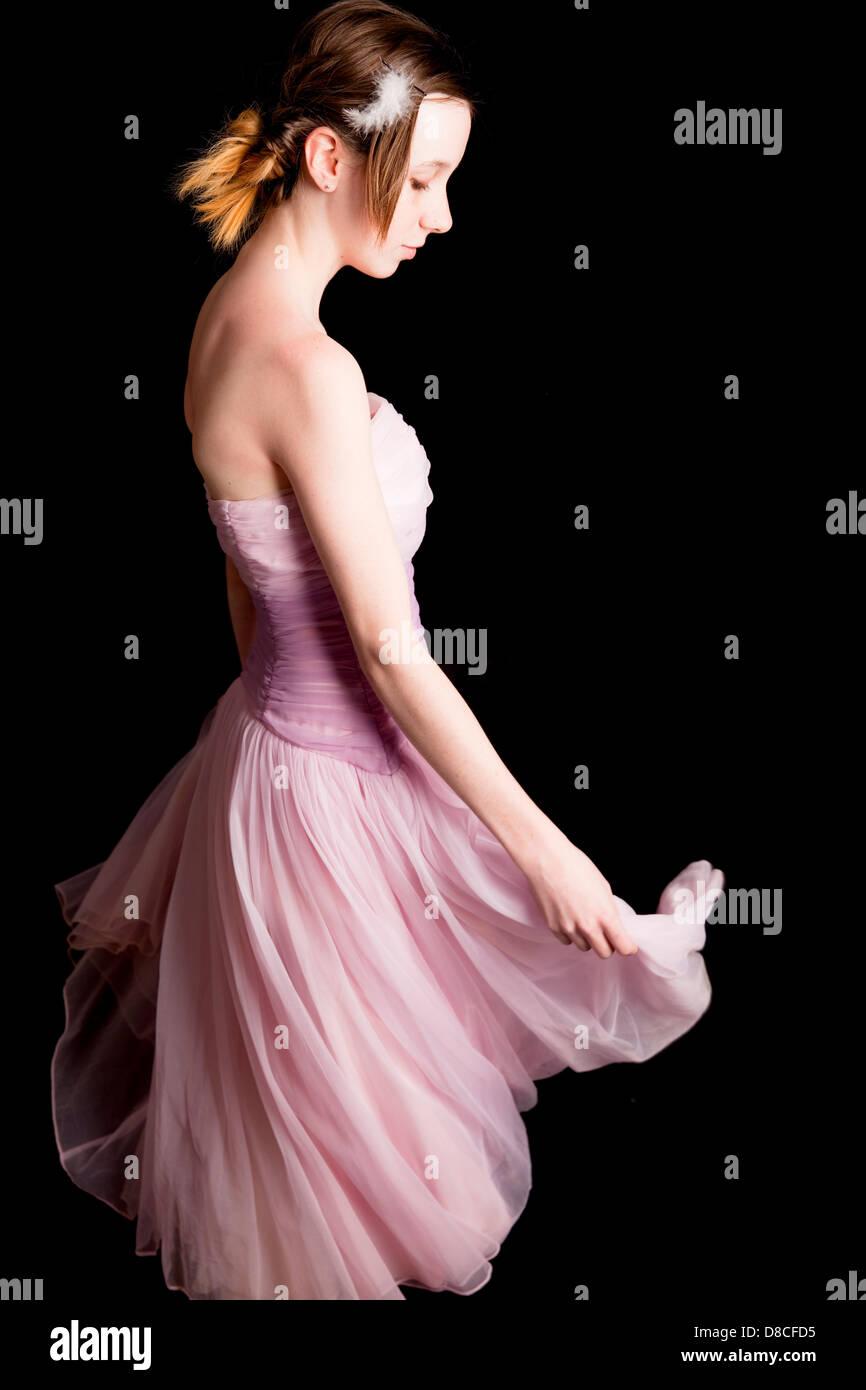 La jeunesse, de l'adolescence, adolescente, rose, premier amour, les rencontres, danse, tournoiement, robe, Photo Stock