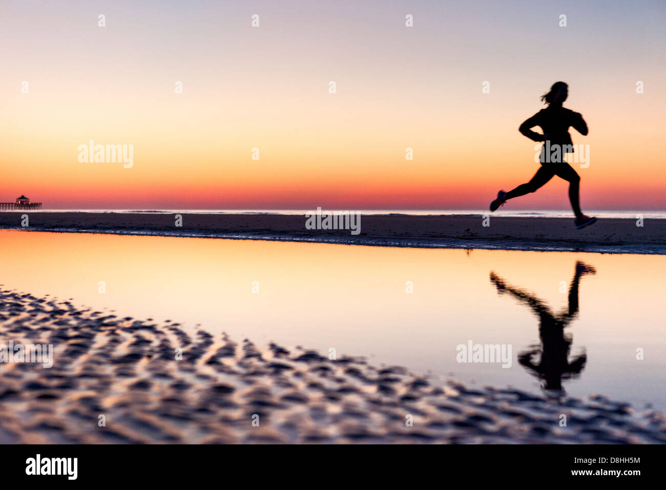 Female jogger at beach Photo Stock