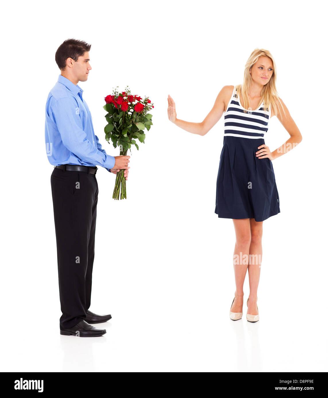 Jeune homme été rejeté par une jeune femme le jour de la Saint-Valentin Photo Stock