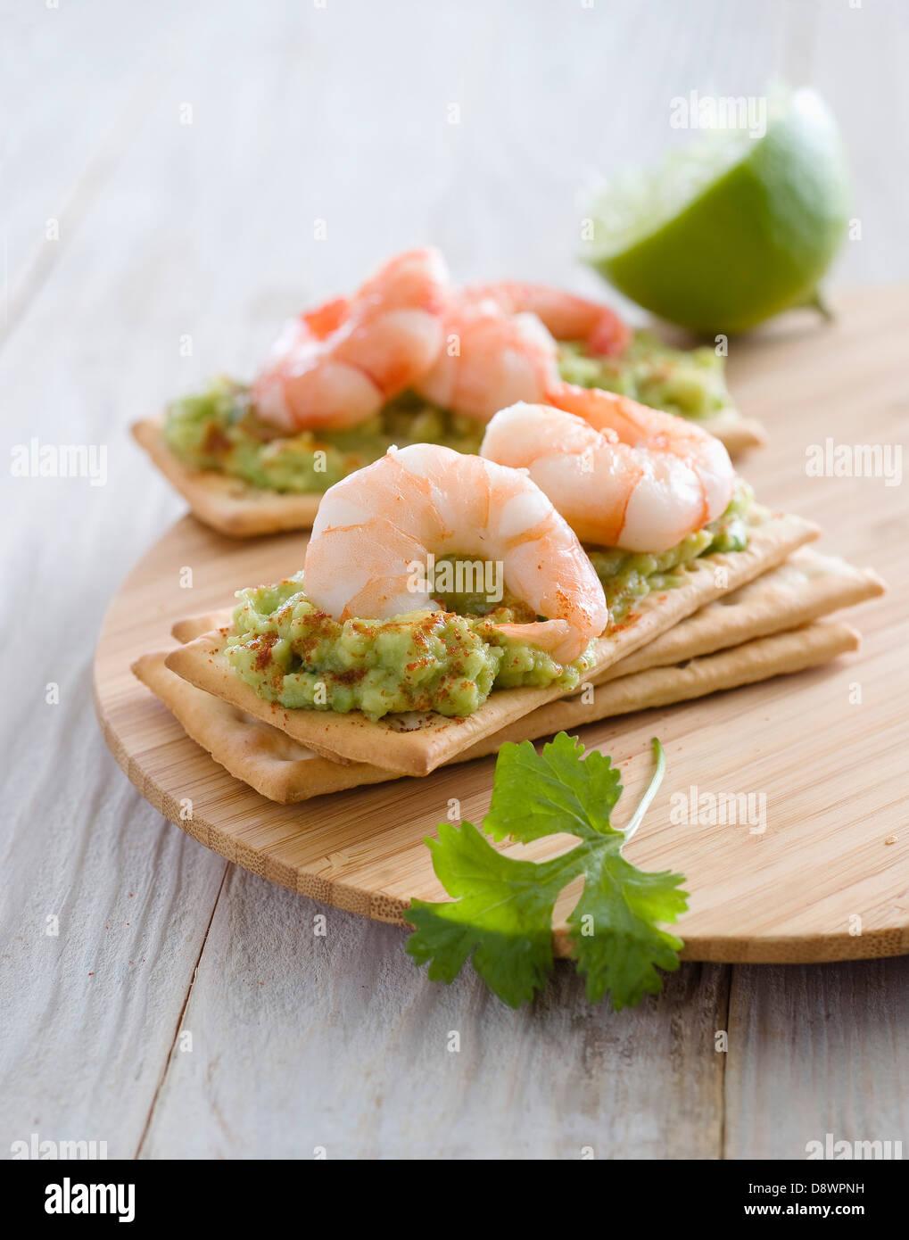 Guacamole et crevettes canapés Photo Stock