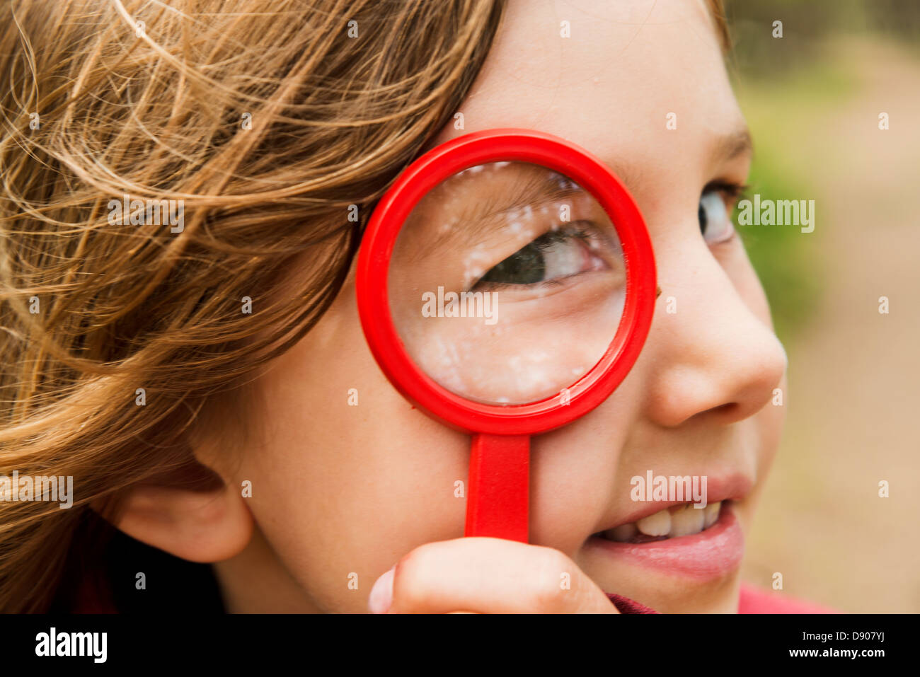 Portrait of Girl with magnifying glass Photo Stock