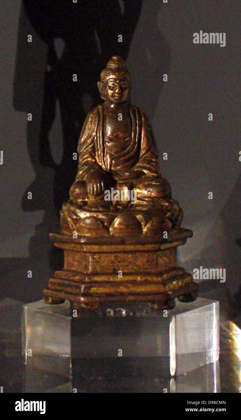 Figure bouddhiste assis, bronze doré, datée 1396. Photo Stock