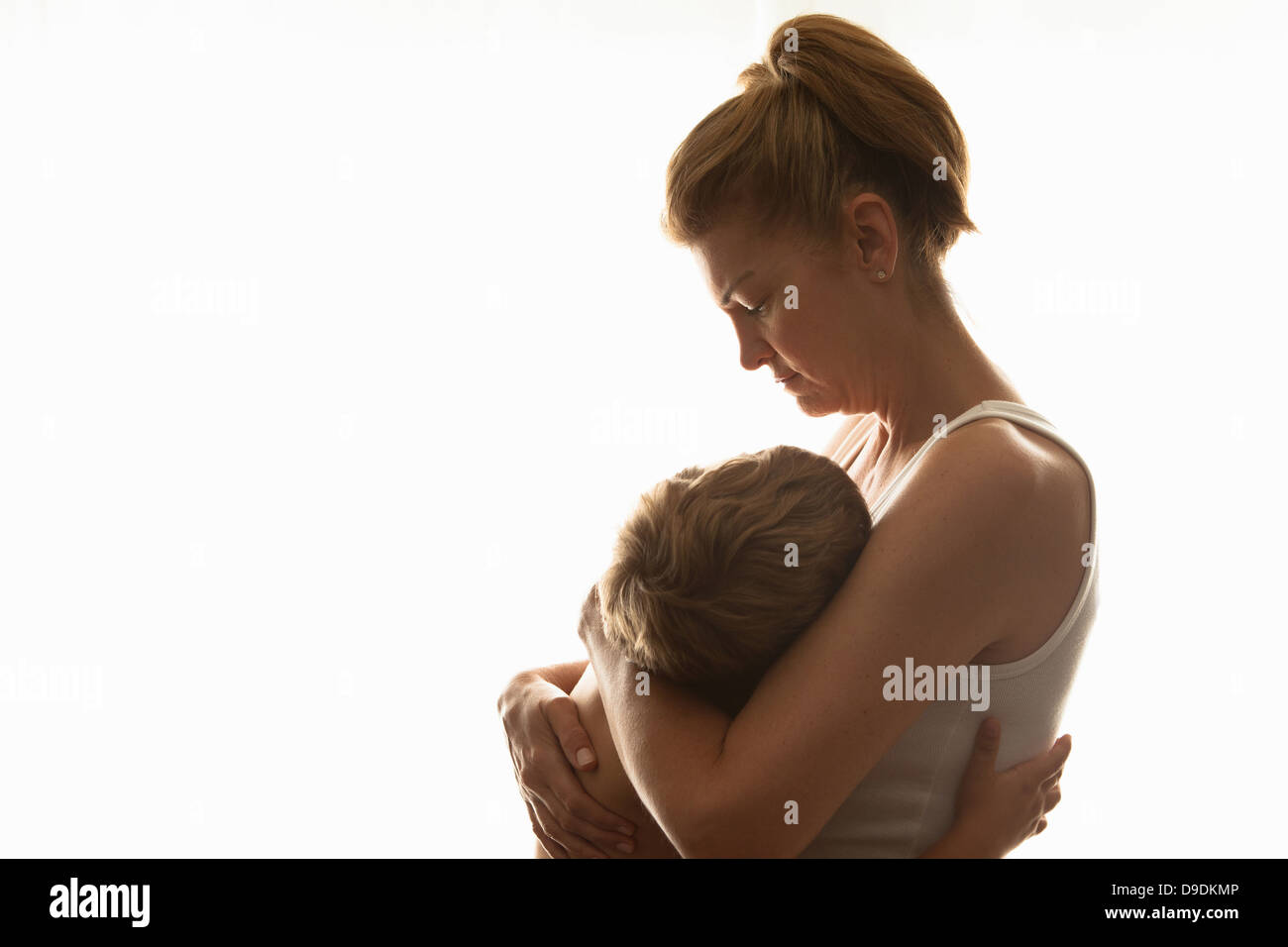 Mother hugging son Photo Stock
