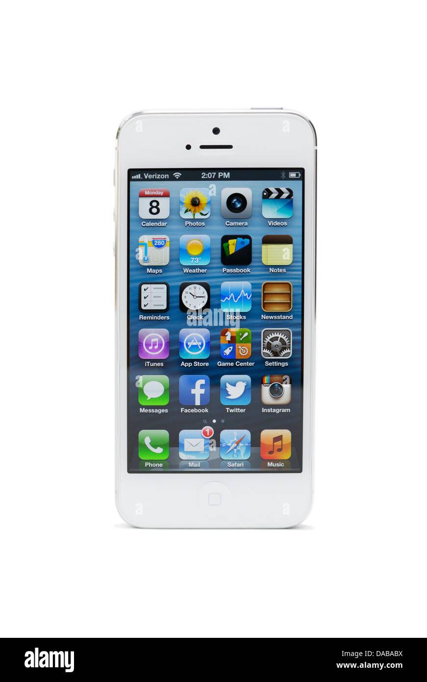 L'iPhone 5 avec des applications sur la page d'accueil Photo Stock