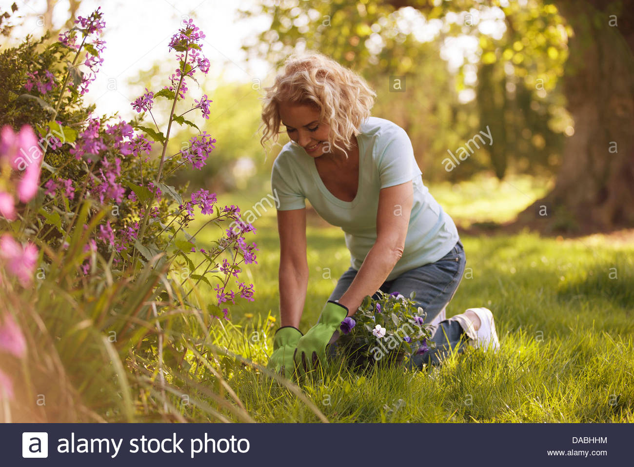 A mature woman gardening Photo Stock