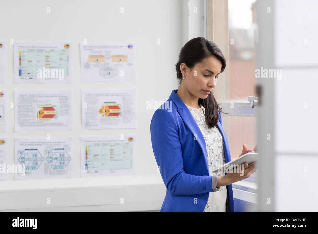 Businesswoman using digital tablet in office Banque D'Images