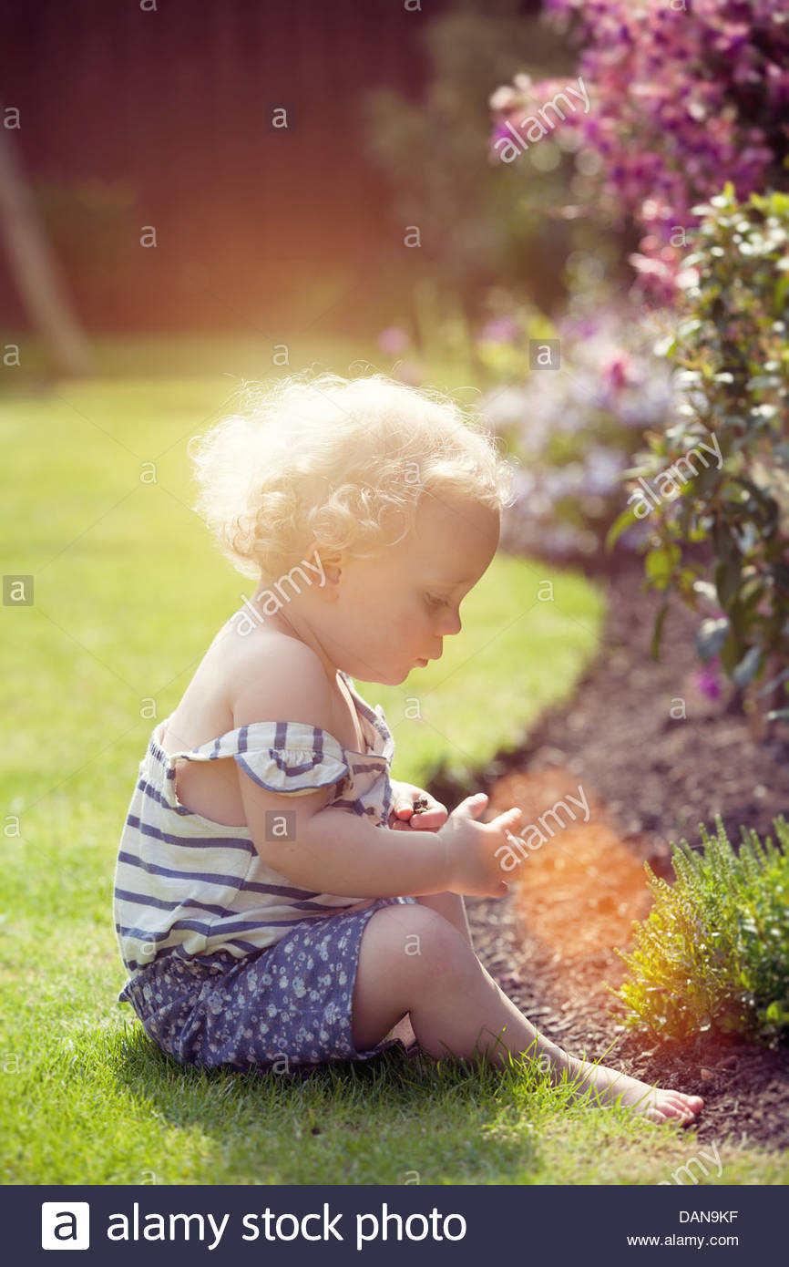 Little girl in garden Photo Stock