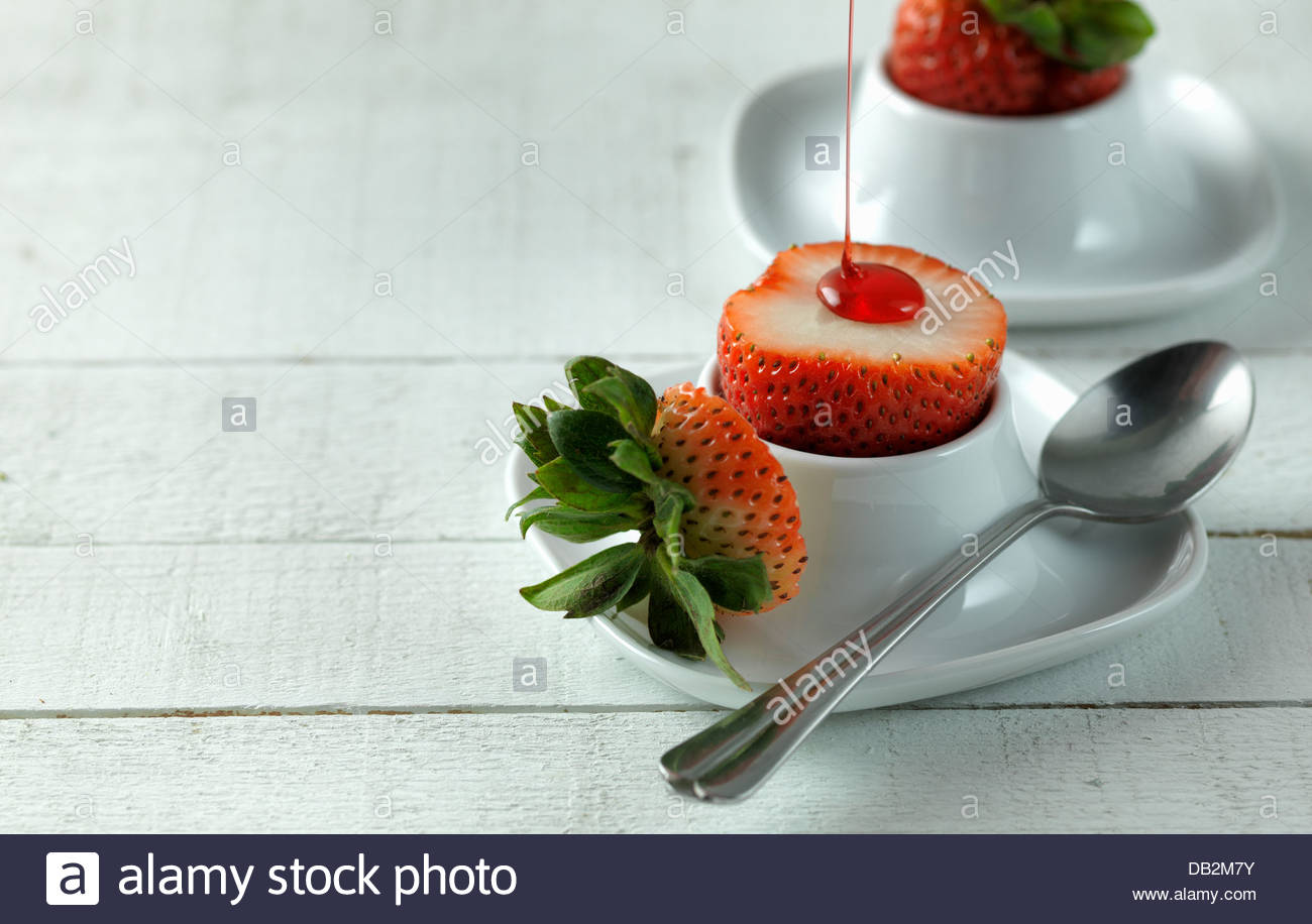 Sirop de fraises arrosées de Photo Stock