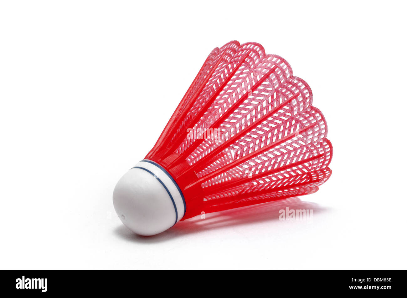 Le joueur de badminton rouge (Birdie) isolated on white Photo Stock