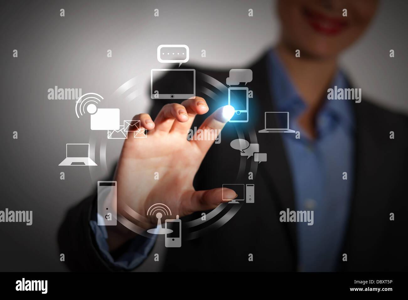 Pousser à la main sur un écran tactile Photo Stock