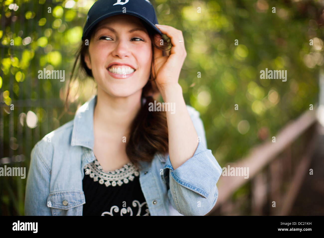 Mid adult woman wearing cap and smiling Photo Stock