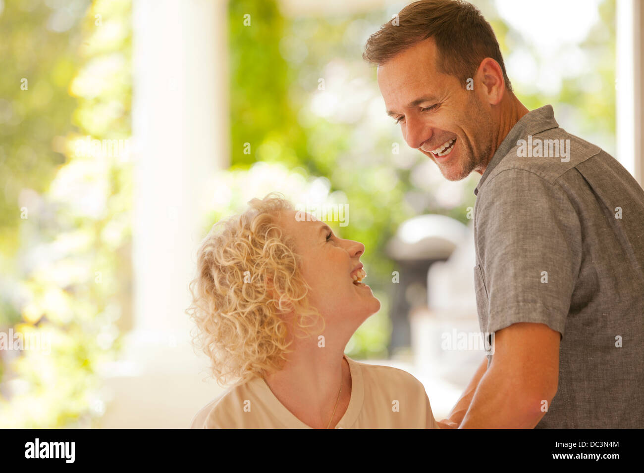 Laughing couple on patio Photo Stock