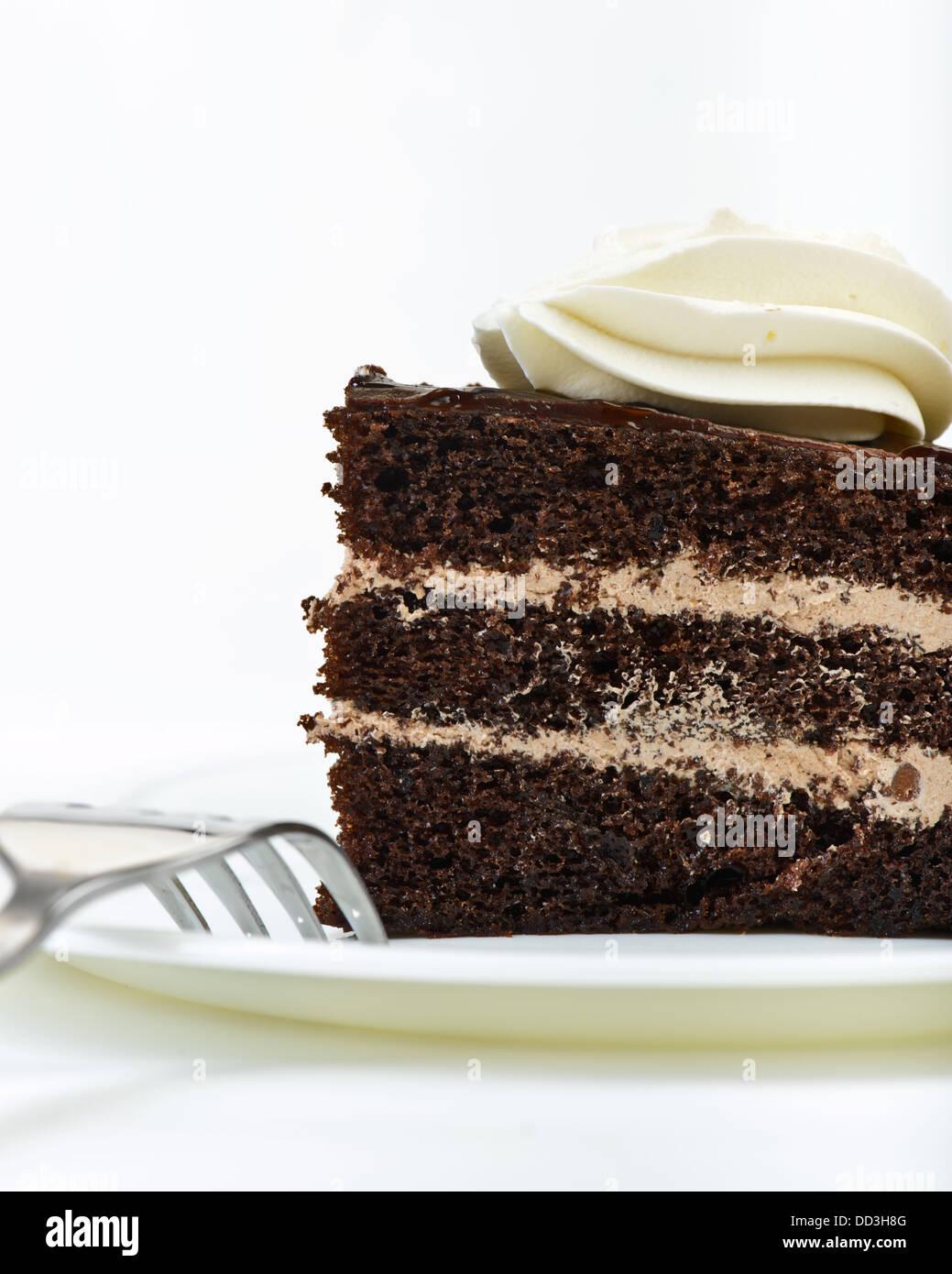 Gâteau au chocolat sur la plaque avec une fourchette Photo Stock