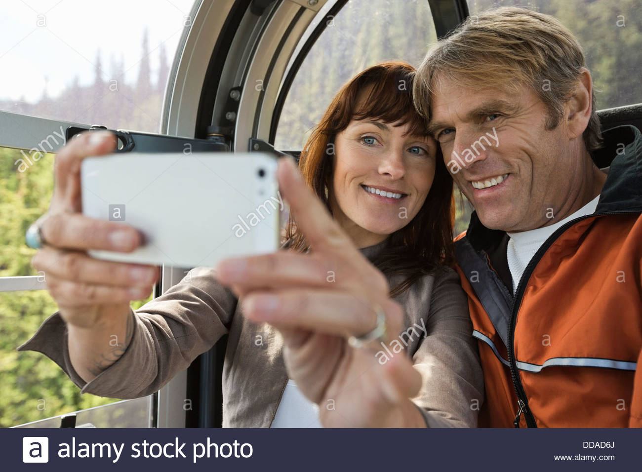 Mature couple taking self-portrait in gondola Photo Stock