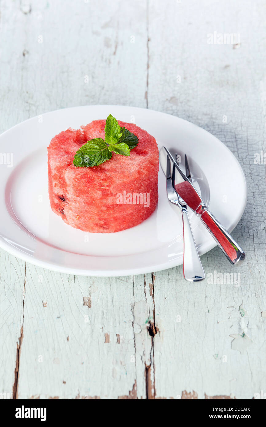Watermelon slice on white plate Photo Stock