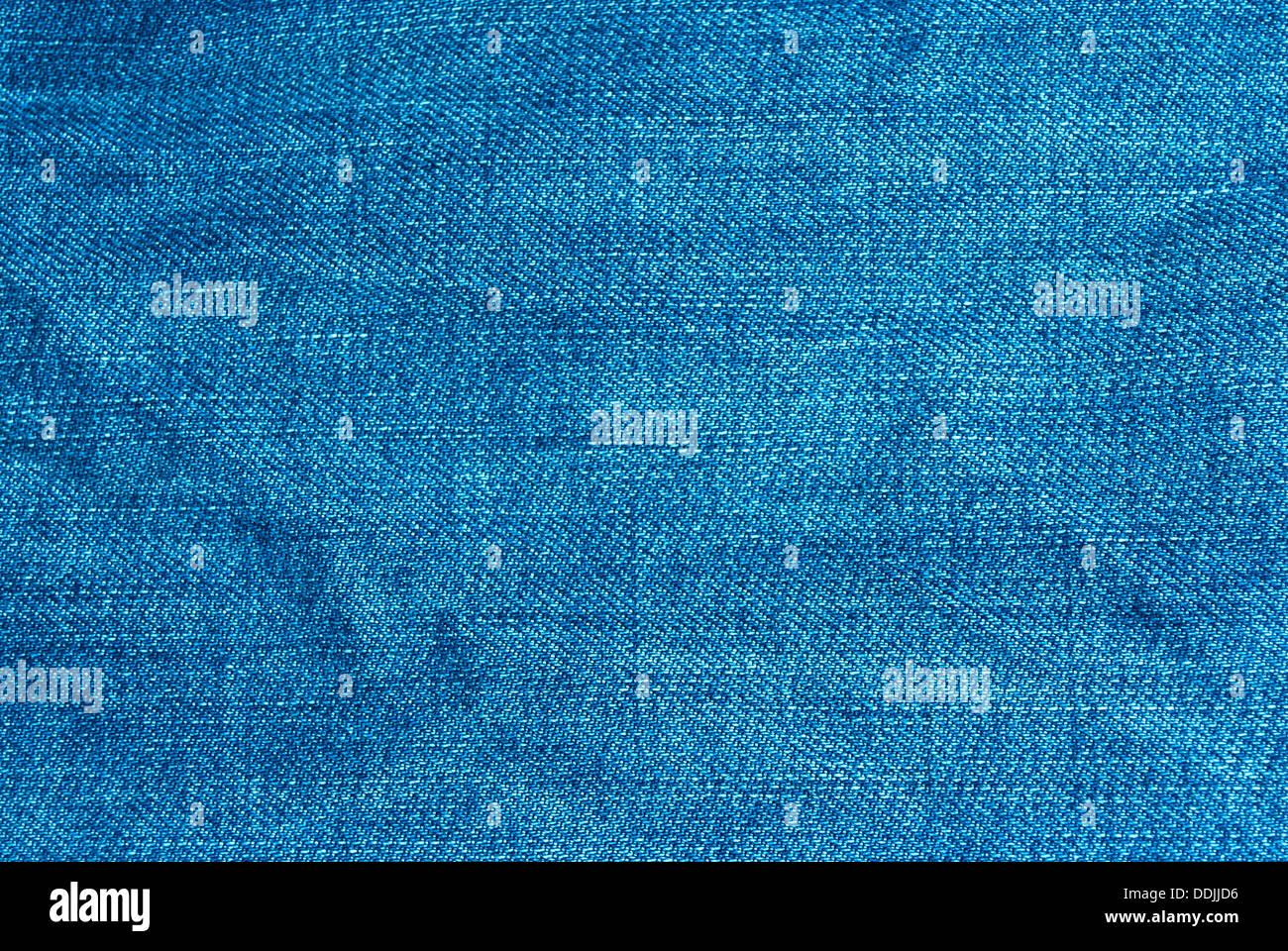 La texture denim bleu de macro pour l'arrière-plan et le papier peint. Photo Stock