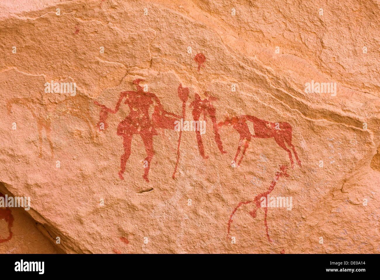 Rock des dessins préhistoriques dans la vallée de l'Akakus Awis, montagnes, désert de Libye, Libye, Sahara, Afrique du Nord, Afrique Photo Stock