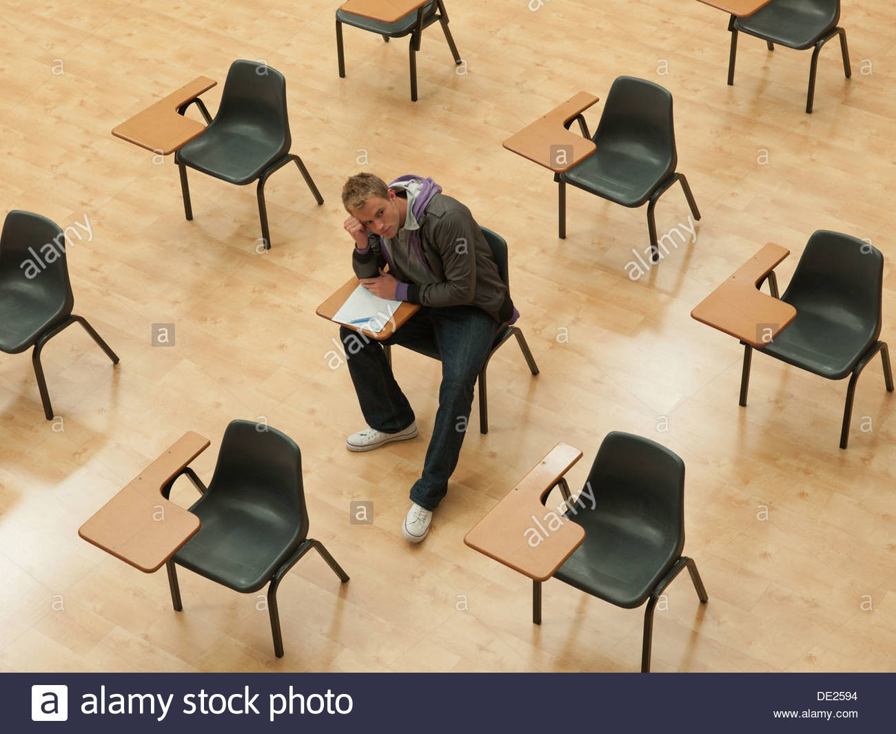 Pensive college student sitting in classroom Photo Stock