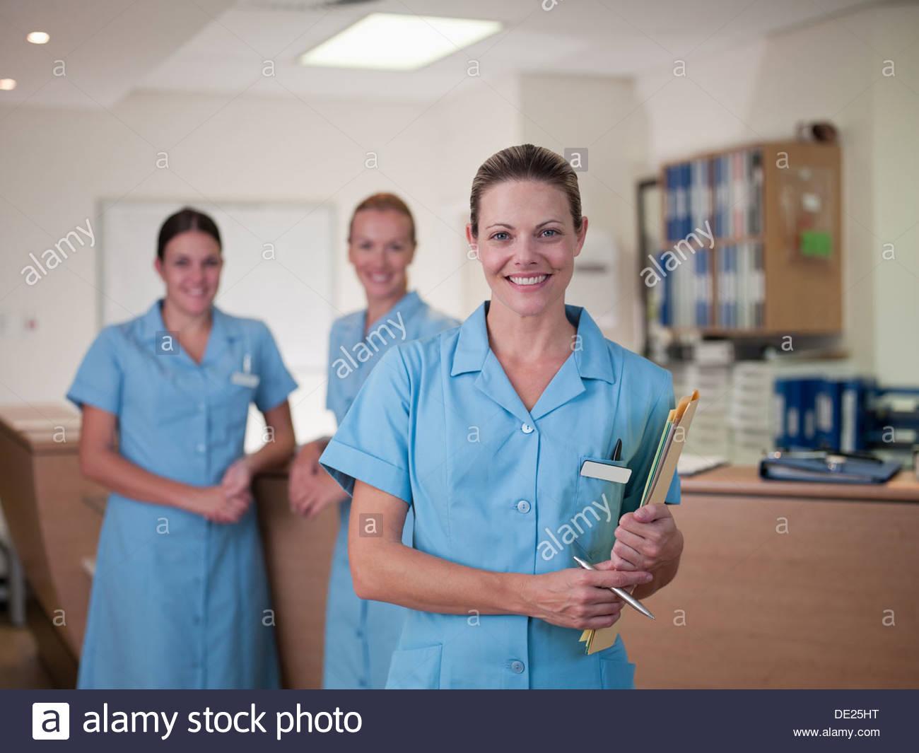 Nurse holding medical chart in hospital Photo Stock